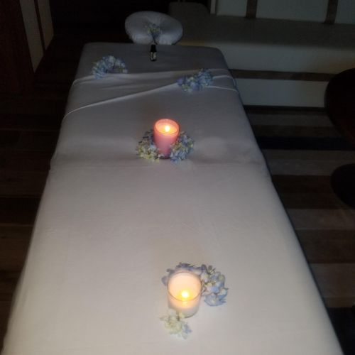 birthday massage with fresh flowers and candles