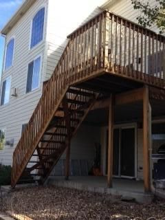 Elevated wood staining restoration deck project