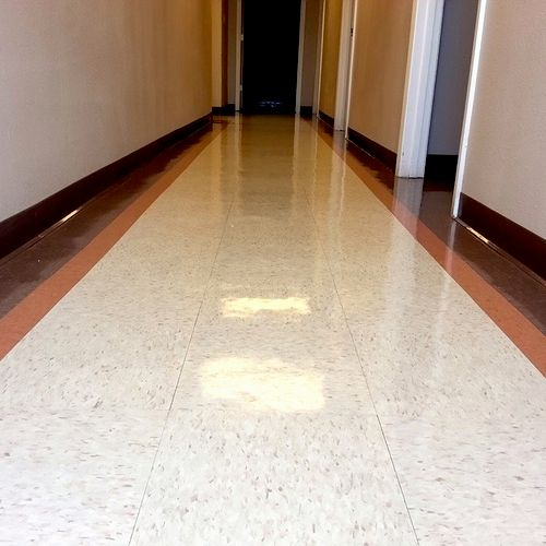Commercial floor. Strip and wax.