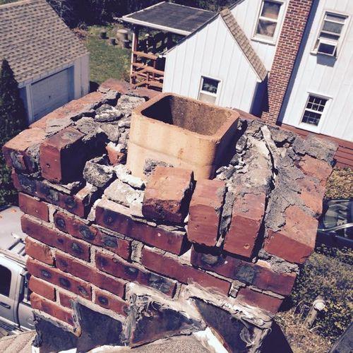 Damaged chimney with loose bricks falling off.