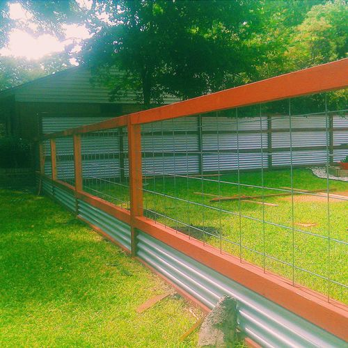 Custom Corrugated metal fence with wood trim and Modern Ranch style fence; all stained with Behr Terra Cota color