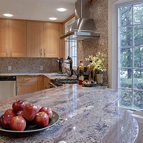 Kitchen renovation,  featuring mosaic iridescent glass tile,  free form shaped granite top, donut frosted glass highats...