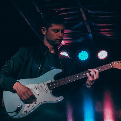 Playing guitar w/Spencer Howard