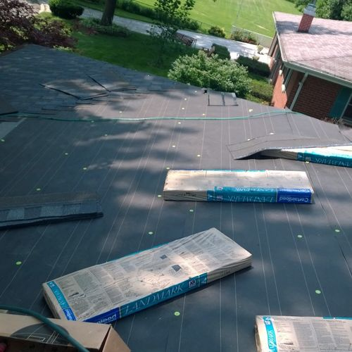 """Here you can see the quality of shingles that are used. The proper installation of a roof with it's 6"""" offsets."""