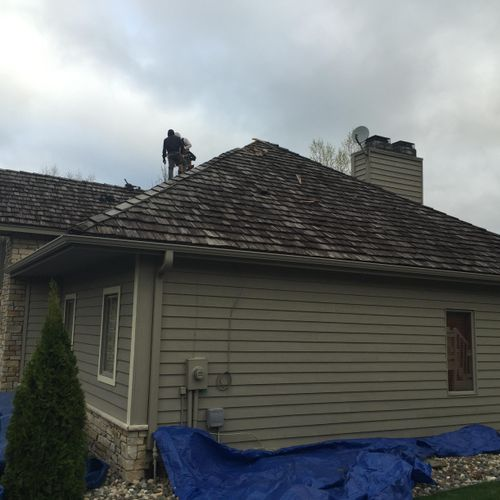 Before. Removal of cedar shake to be replaced with Asphalt shingles.