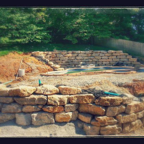 Boulder retaining walls for pool