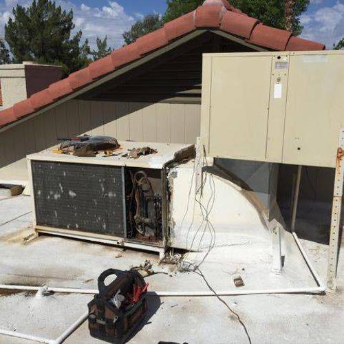 Goettl Over/Under packaged heat pump to downflow piggy-back cooler on flat foam-in roof BEFORE