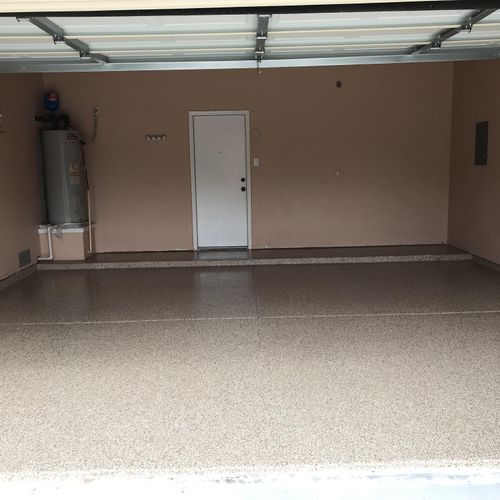After - The same floor but now sporting a new Full Broadcast PolyAspartic coating that will last a very long time!