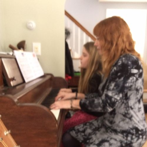 Accompanying a student at an in home recital