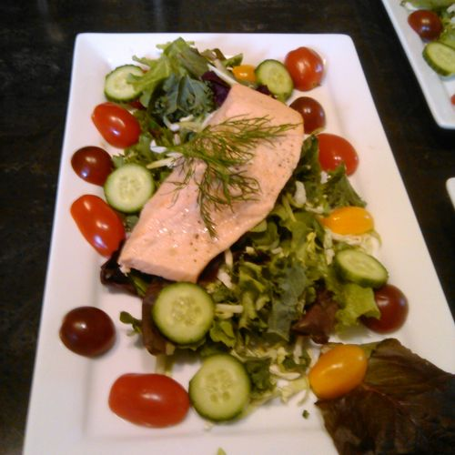 Poached Salmon over field greens