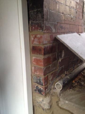 After repair of crumbling brick on doorframe