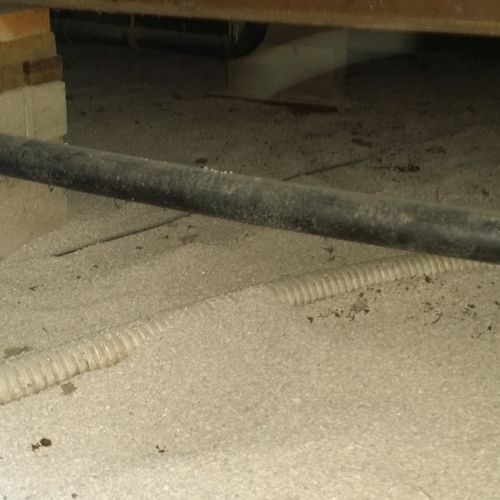 The after picture of a crawlspace after a sewage backup clean up and absorbent material applied
