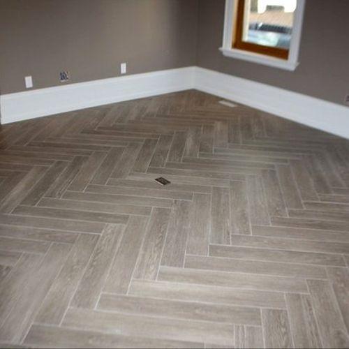 Ceramic tile floor in herringbone pattern  Wall & Floor tiling; Showers, floors, walls, ceilings, backsplash