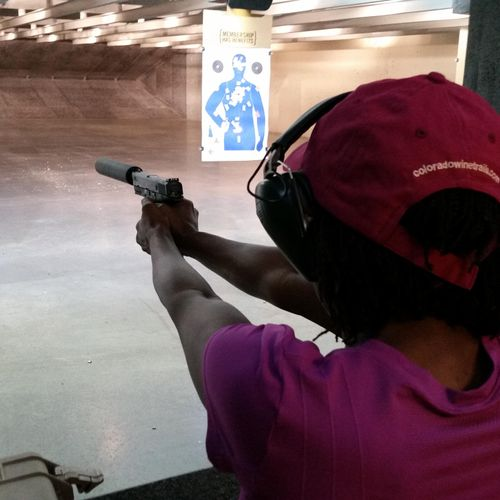 A student who has never shot a handgun in her life; now safely, enjoyably, & accurately shooting a large caliber pistol!