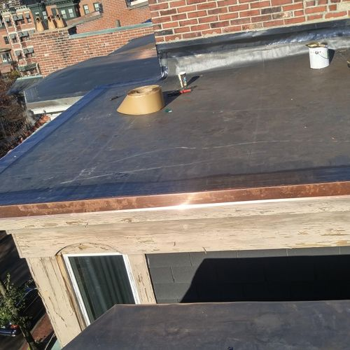 small EPDM roof with copper edge metal in the South End