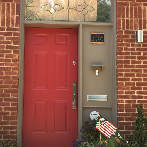 Painted the door and trim, and replaced house numbers, mail slot, and doorbell.