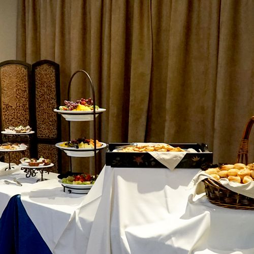 So many great items at this Ivy House reception. Including - Homemade herb cheese bread, bacon quiche bites, spice cake, mexican brownies spiced with a pinch of cayenne pepper and more.