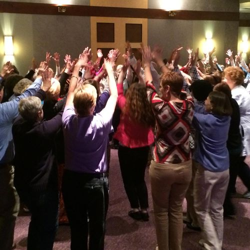 Group laughter exercises at Baptist Health Lexington symposium