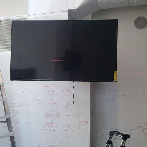 Installation of TV mount.