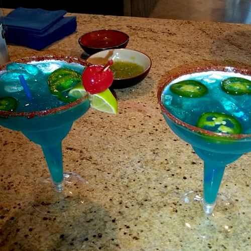 JD Bartending will help you come up with the perfect festive signature drink! Pictured: Spicy Blue Margarita...a hit with the guests!