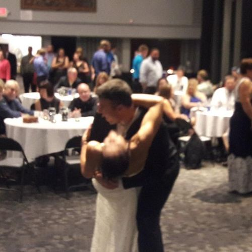 Husband dips his bride during their first dance