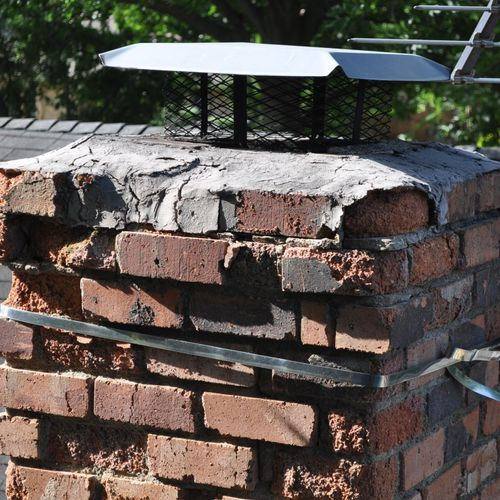 Antenna strap around chimney accelerating deterioration of brick