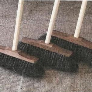 A Broom and 3 Ladies
