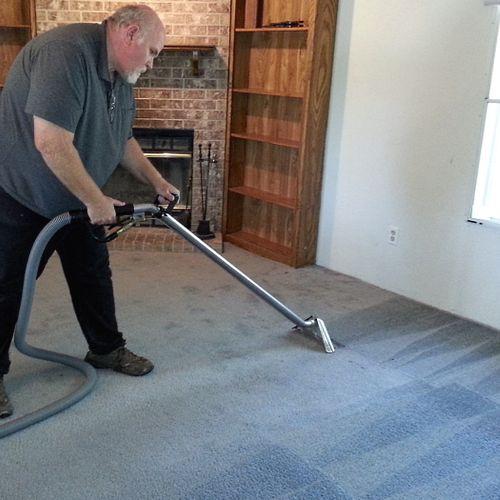 Carpet cleaning in progress.