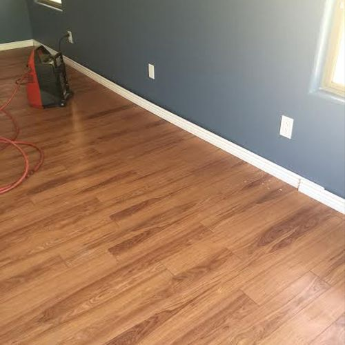 This is a laminate flooring installation with new trim.