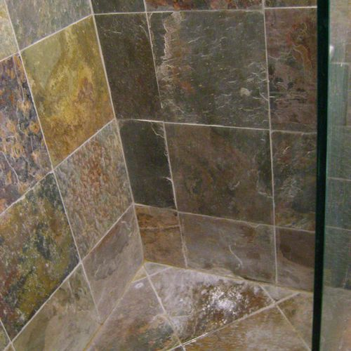 Before: Slate shower with hard water marks