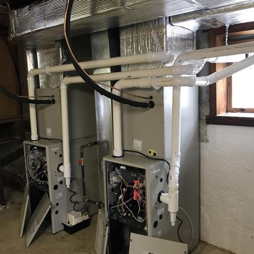 High efficiency central heating and air-conditioning for a duplex which included all ductwork throughout both units.