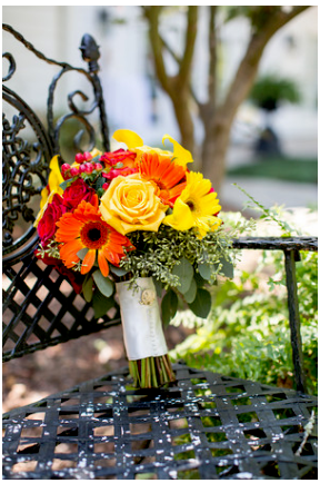 Beautiful fall bouquet using Gerber Daisy and Roses in yellow, orange and red.