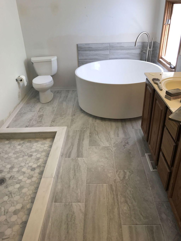 custom tile shower pan and fish bowl tub