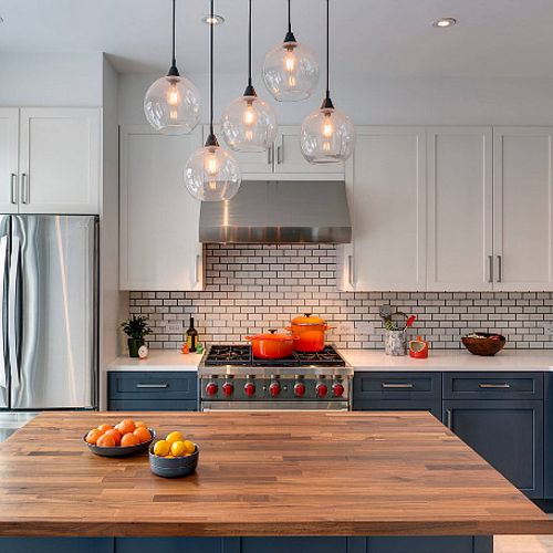 Blue base cabinets and butcher block island really give character to this kitchen.
