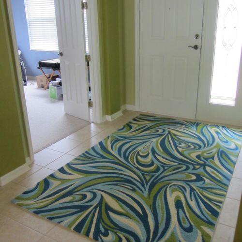 Fun multi- color area rug in entrance area.