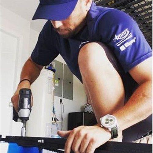 Tech installing garage opener