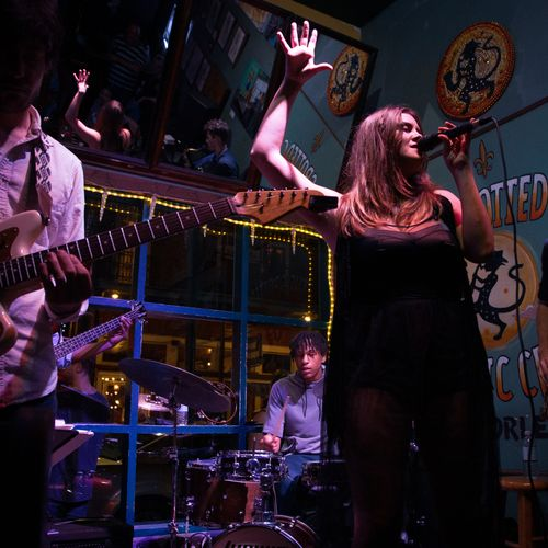 Singing at my weekly residency with Inner Wild at the Spotted Cat which I held for 9 years