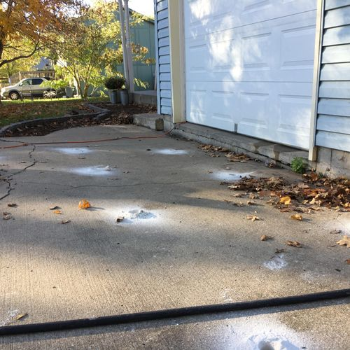 """8"""" driveway lift about to occur, holes are drilled and ready for slurry"""