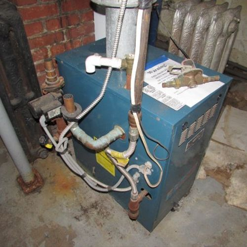 Attempted boiler repair by a home owner.  !!
