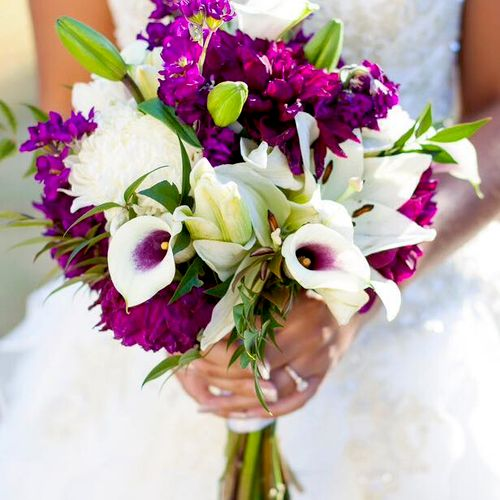 This is a show stopper with vibrant purple dahlias, white lilies, purple stock and Picasso Vermeer calla lilies. Great October wedding. Photo credit Live Free Photography