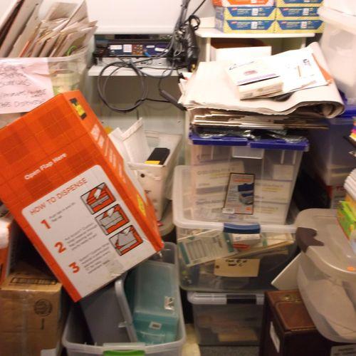 Stationery cupboard before organizing