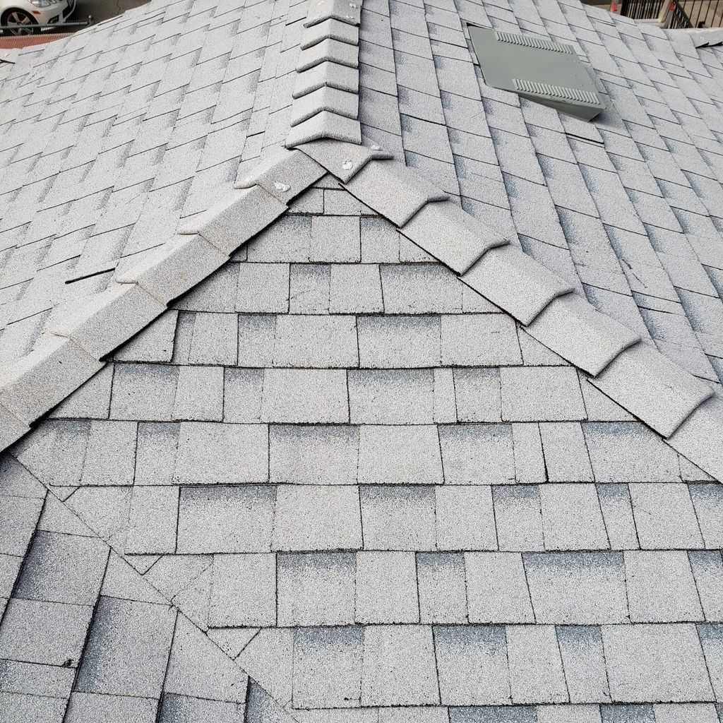 Economy Roofing and Construction