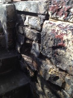 Before photos of a deteriorated basement entry building plus 100 yrs