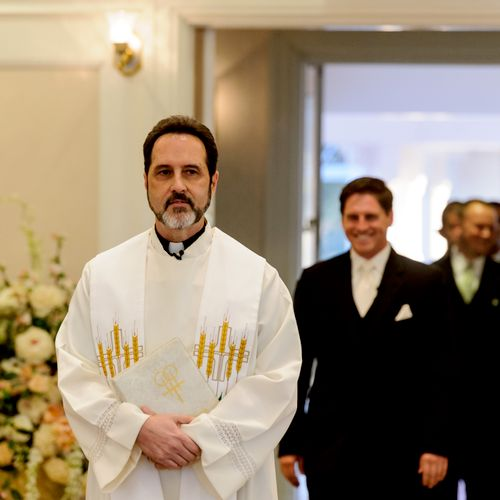 Leading the Groom and Groom's men down the isle in the wedding chapel at Disney World