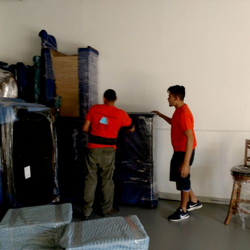 One of my Crew's hard at work storing a customers belongs into one of our many available storage units