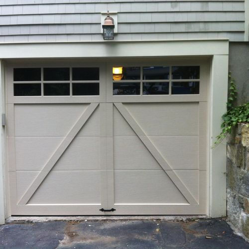 A shaped semi custom steel insulated in taupe color with insulated glass , R value16  Fairfield CT