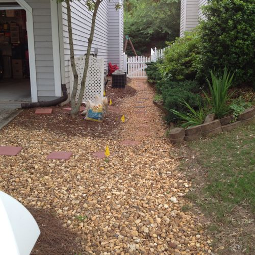 1-Before: Mayor drainage problem! Water was staying due to the fact that it did not have any fall nor swale (John R.)