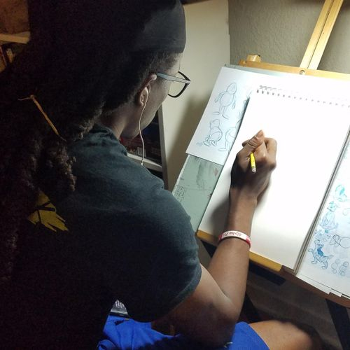 Student learning to draw cartoon characters.