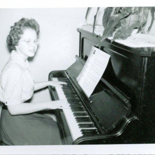 Gloria Huffman, age 13, practicing piano in 1960.