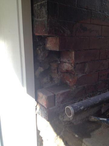 Before photo of crumbling brick on doorframe